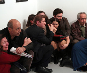 Gallery goers cower after Mevlut Mert Altintas shot Andrei Karlov, the Russian ambassador to Turkey, at an art gallery in Ankara, Turkey, Monday, Dec. 19, 2016. At first, AP photographer Burhan Ozbilici thought it was a theatrical stunt when a man in a dark suit and tie pulled out a gun during the photography exhibition. The man then opened fire, killing Karlov. (AP Photo/Burhan Ozbilici)